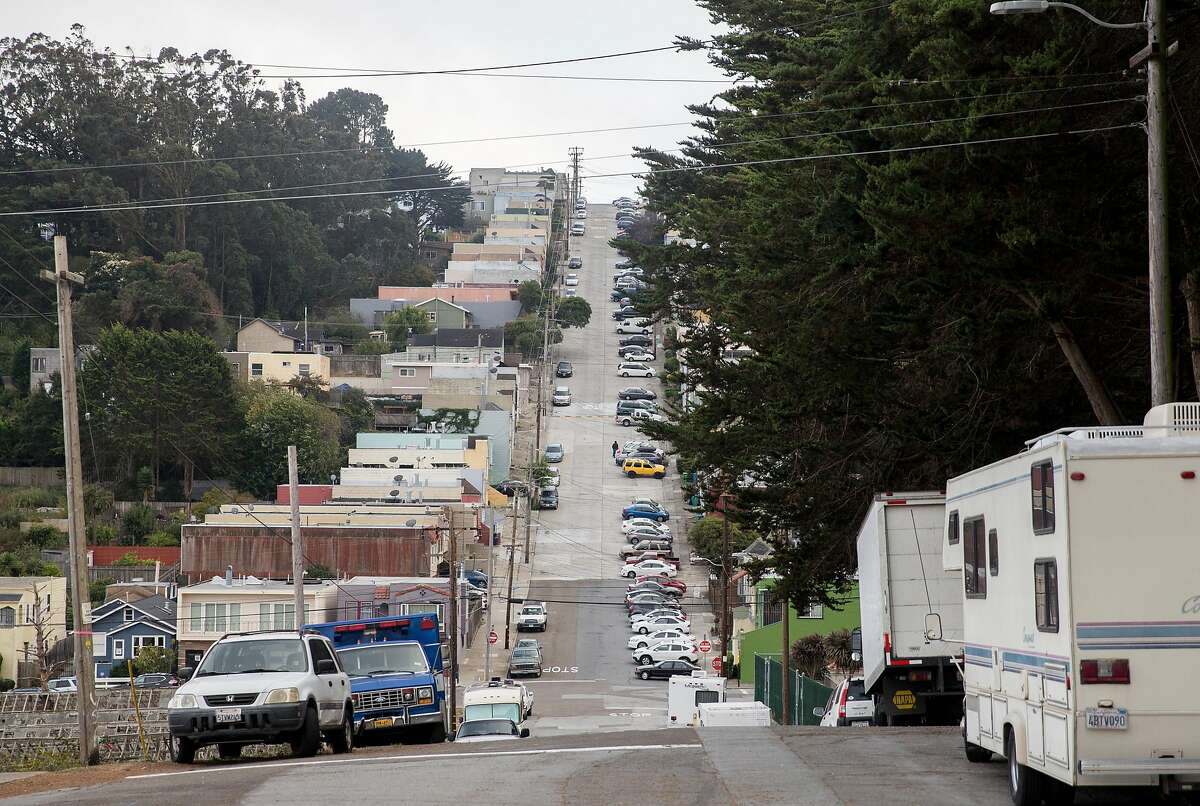 Multiple RVs and cars are seen parked along Bowdoin Street near North Basin reservoir in the Portola neighborhood of San Francisco, Calif. Tuesday, Oct. 9, 2018.