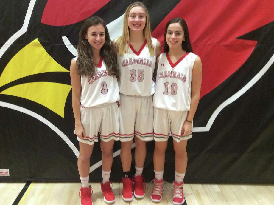 From left to right, junior Jordan Moses, senior Taylor Stamos and senior Michelle Morganti are captains of the Greenwich High School girls basketball team, which celebrated Senior Night on Tuesday against Wilton. Photo: David Fierro / Hearst Connecticut Media / Hearst Connecticut Media / Connecticut Post