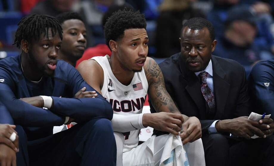 Sunday's game against Memphis will be UConn's first without senior Jalen Adams, center, who is out for the next four to six weeks. Photo: Jessica Hill / Associated Press / Copyright 2019 The Associated Press. All rights reserved