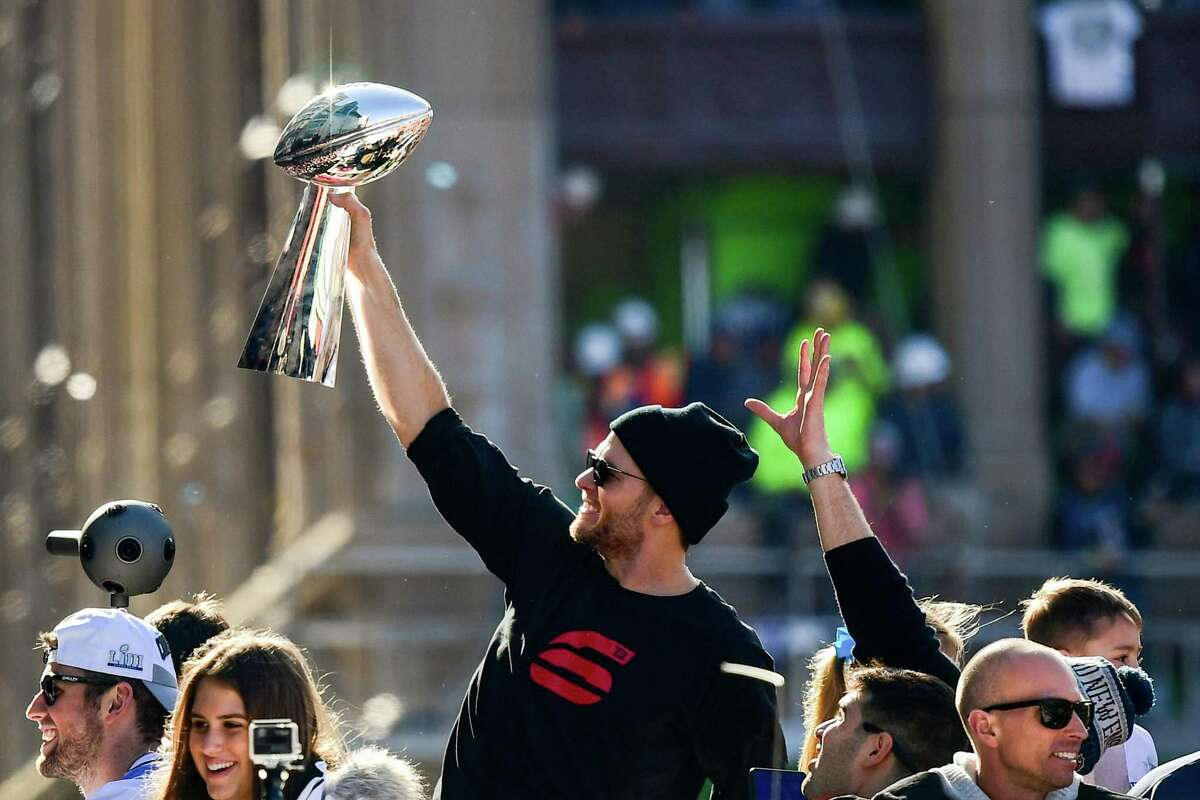 BOSTON, MASSACHUSETTS - FEBRUARY 05: Tom Brady #12 of the New England Patriots reacts as he holds the Vince Lombardi trophy during the Super Bowl Victory Parade on February 05, 2019 in Boston, Massachusetts. (Photo by Billie Weiss/Getty Images)