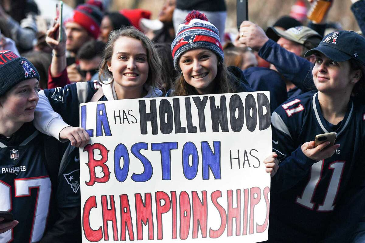 BOSTON, MASSACHUSETTS - FEBRUARY 05: Fans display signs during the Super Bowl Victory Parade on February 05, 2019 in Boston, Massachusetts. (Photo by Billie Weiss/Getty Images)