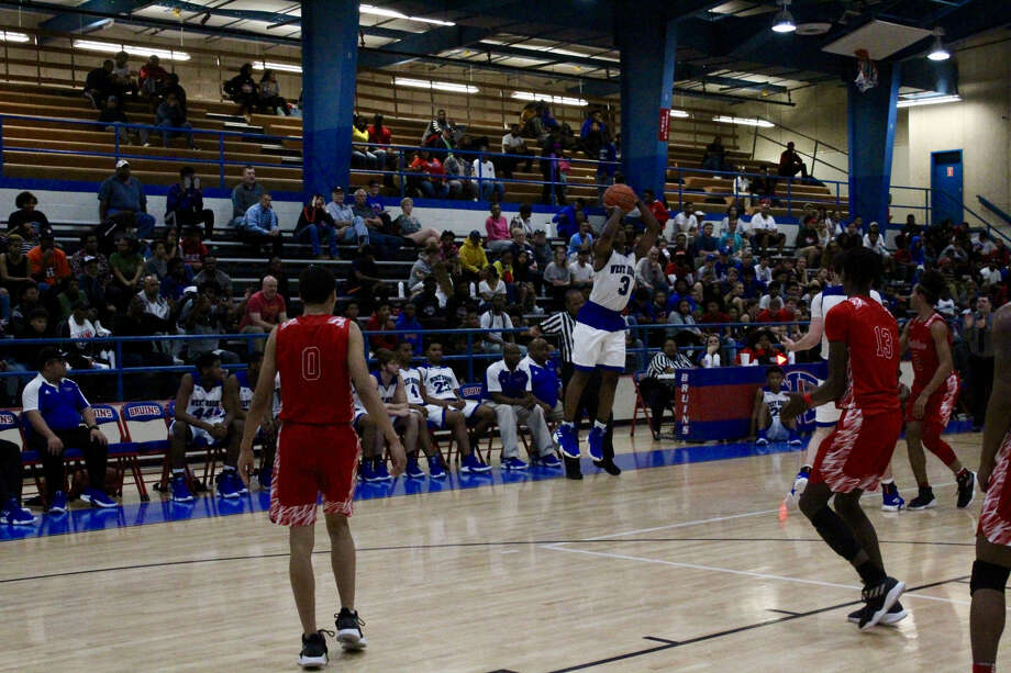 West Brook's Peter Simon shoots a three-point against North Shore on Tuesday night at West Brook High School. Photo: Meshach Sullivan  / The Enterprise