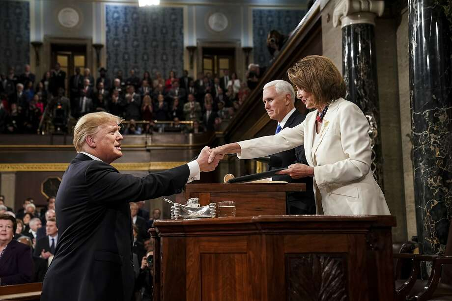 President Donald Trump shakes hands with House Speaker Nancy Pelosi as Vice President Mike Pence looks on, as he arrives in the House chamber before giving his State of the Union address to a joint session of Congress, Tuesday, Feb. 5, 2019 at the Capitol in Washington. Photo: Doug Mills, Associated Press