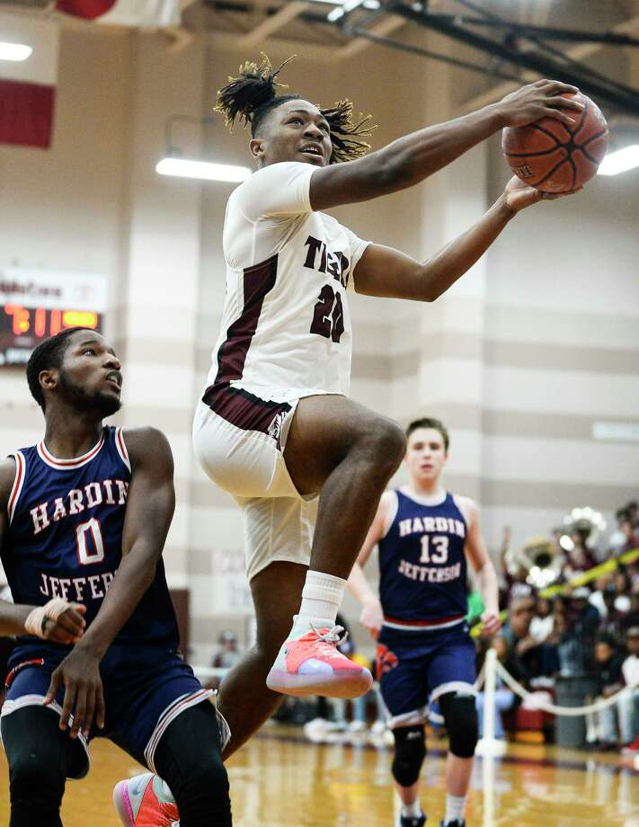 Silsbee's Chris Martin jumps up for a layup against Hardin-Jefferson during the first quarter of the game at Silsbee on Tuesday.