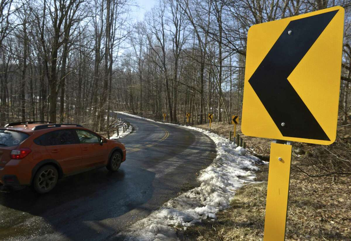 Curve signs, part of federal grant to make roads safer, installed on Big Bear Hill Road in New Milford, Conn. February 5, 2019.