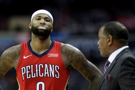 WASHINGTON, DC - DECEMBER 19: DeMarcus Cousins #0 of the New Orleans Pelicans talks with head coach Alvin Gentry in the first half against the Washington Wizards at Capital One Arena on December 19, 2017 in Washington, DC. NOTE TO USER: User expressly acknowledges and agrees that, by downloading and or using this photograph, User is consenting to the terms and conditions of the Getty Images License Agreement. (Photo by Rob Carr/Getty Images) Photo: Rob Carr / Getty Images / 2017 Getty Images