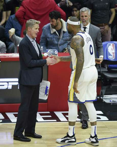 Golden State Warriors center DeMarcus Cousins, right, shakes hands with head coach Steve Kerr after being taken out of the game during the third quarter against the Los Angeles Clippers on Friday, Jan. 18, 2019 in Los Angeles, Calif. Photo: Kelvin Kuo / Special To The Chronicle / online_yes