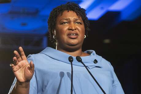 FILE - In this Nov. 6, 2018 file photo, then Georgia Democratic gubernatorial candidate Stacey Abrams addresses supporters during an election night watch party in Atlanta. Abrams will deliver her party's response to President Trump's State of the Union by arguing for a more unified society that gives every American a chance at prosperity. (AP Photo/John Amis)
