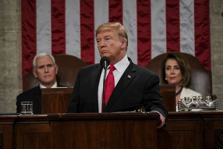 President Donald Trump gives his State of the Union address to a joint session of Congress, Tuesday, Feb. 5, 2019 at the Capitol in Washington, as Vice President Mike Pence, left, and House Speaker Nancy Pelosi look on. (Doug Mills/The New York Times via AP, Pool) Photo: Doug Mills / The New York Times Via AP, Pool