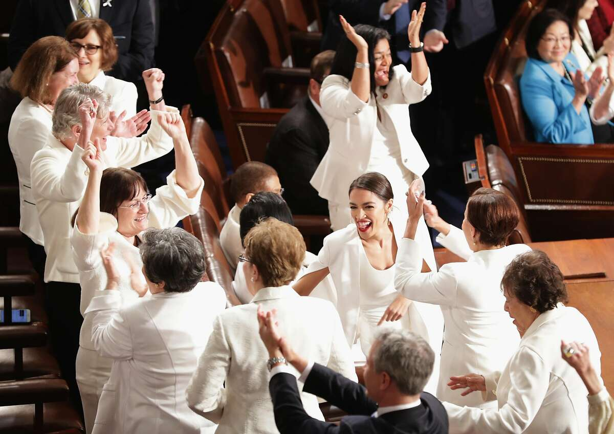 Female lawmakers cheer during President Donald Trump's State of the Union address in the chamber of the U.S. House of Representatives at the U.S. Capitol Building on February 5, 2019 in Washington, DC. A group of female Democratic lawmakers chose to wear white to the speech in solidarity with women and a nod to the suffragette movement.