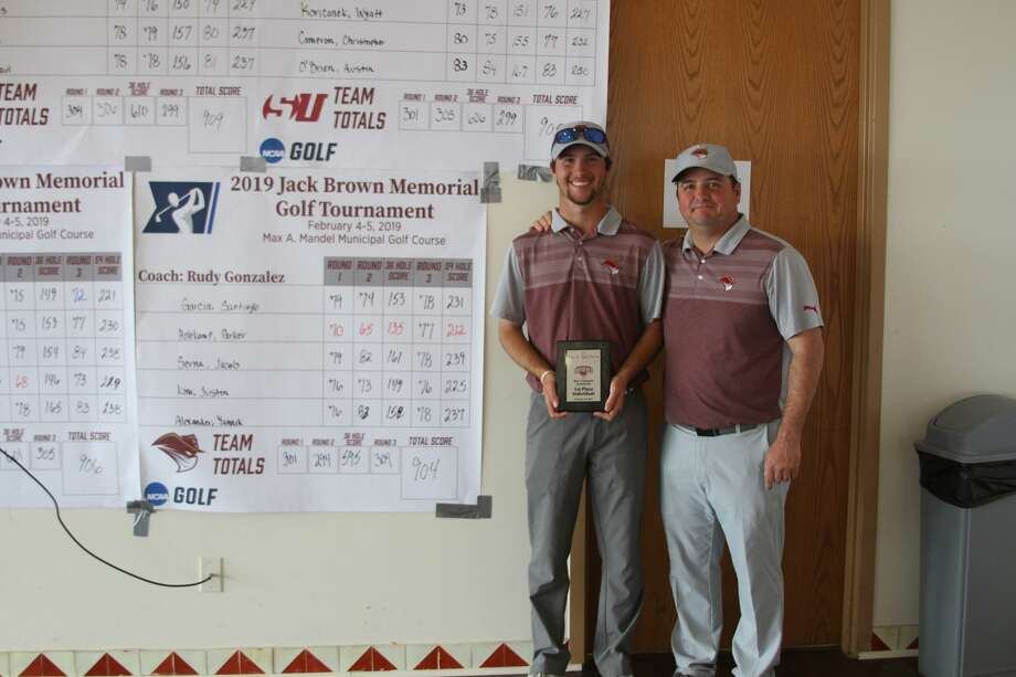 TAMIU's Parker Holekamp, standing next to head coach Rudy Gonzalez, won the 2019 Jack Brown Memorial Invitational after finishing 4-under after three rounds of play on Tuesday. Photo: Courtesy Of TAMIU Athletics