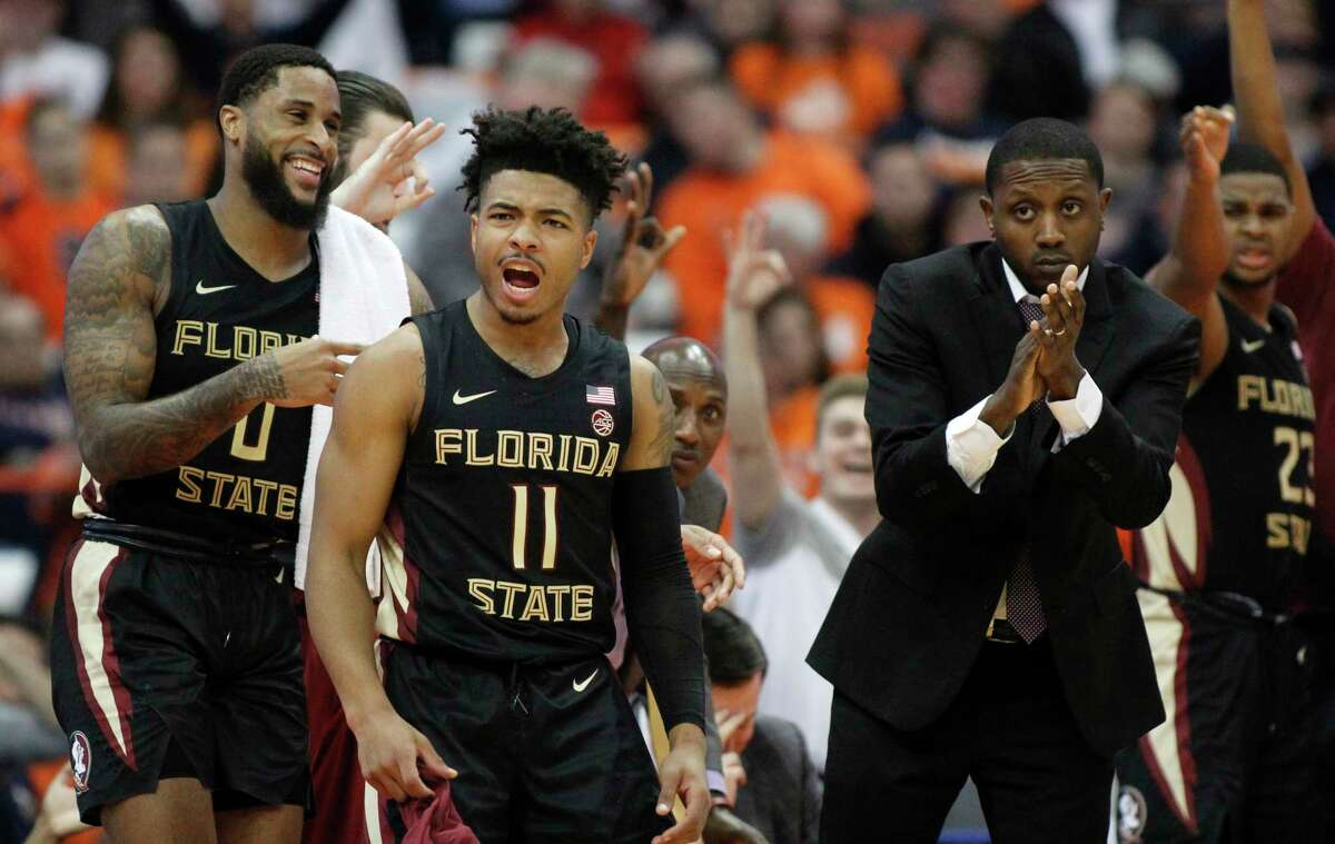 Florida State's David Nichols, center, leads the cheer from the bench during the second half of an NCAA college basketball game against Syracuse in Syracuse, N.Y., Tuesday, Feb. 5, 2019. Florida State won 80-62. (AP Photo/Nick Lisi)