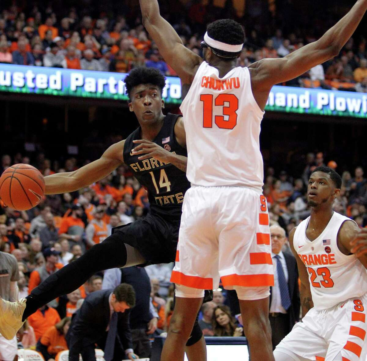 Florida State's Terance Mann, left, passes around Syracuse's Paschal Chukwu, right, during the first half of an NCAA college basketball game in Syracuse, N.Y., Tuesday, Feb. 5, 2019. (AP Photo/Nick Lisi)