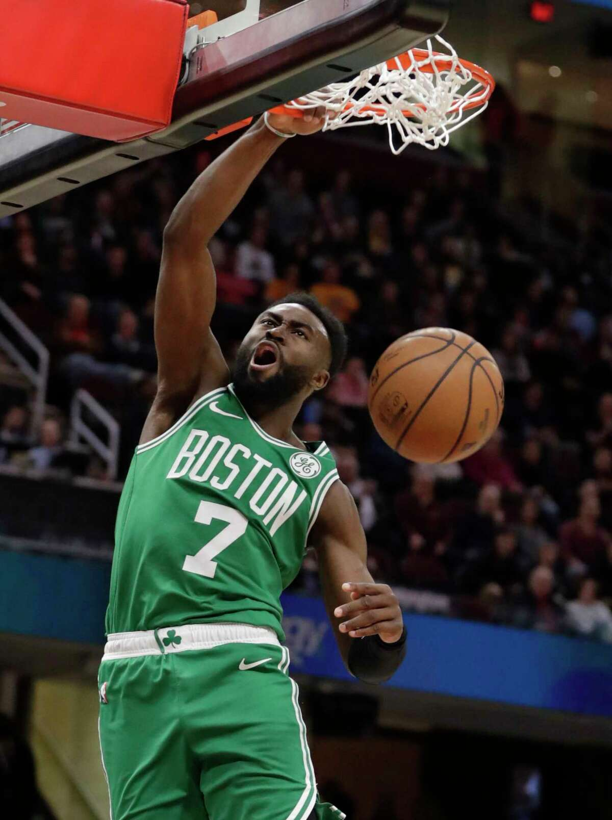 Boston Celtics' Jaylen Brown dunks against the Cleveland Cavaliers during the first half of an NBA basketball game Tuesday, Feb. 5, 2019, in Cleveland. (AP Photo/Tony Dejak)
