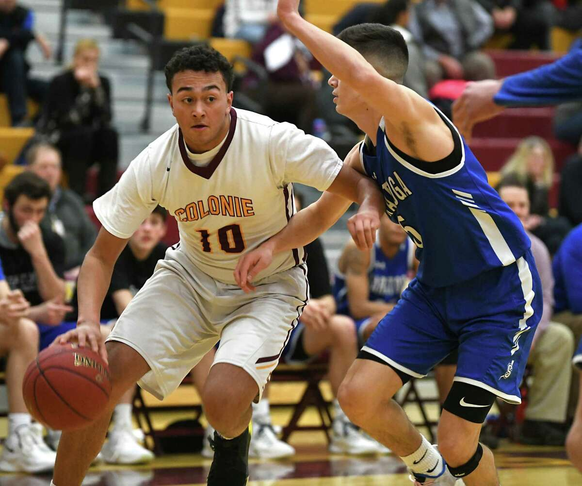 Colonie's Aaron Satin drives to the basket guarded by Saratoga's Aidan D'Agostino during a basketball game on Tuesday, Feb. 5, 2019 in Colonie, N.Y. (Lori Van Buren/Times Union)