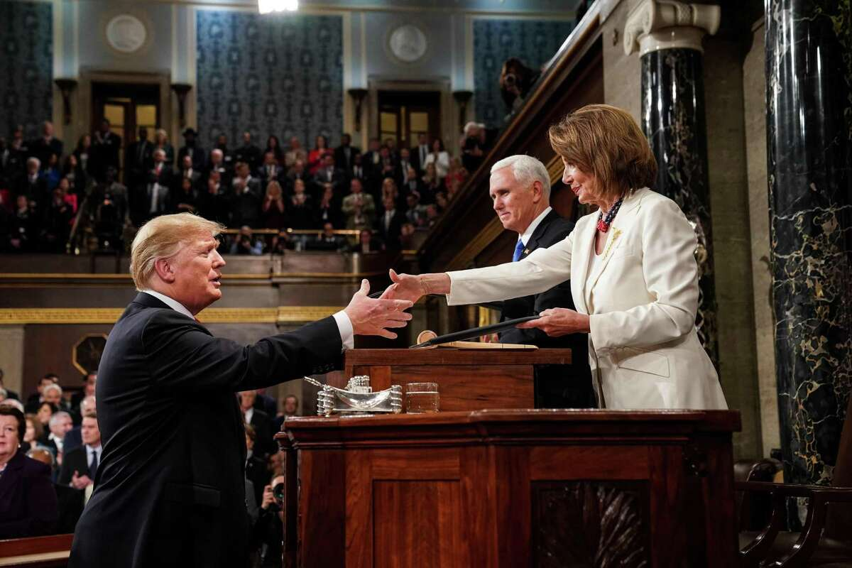 US President Donald Trump greets Speaker of the House Nancy Pelosi, alongside Vice President Mike Pence, as he arrives to deliver the State of the Union address at the US Capitol in Washington, DC, on February 5, 2019. (Photo by Doug Mills / POOL / AFP)DOUG MILLS/AFP/Getty Images