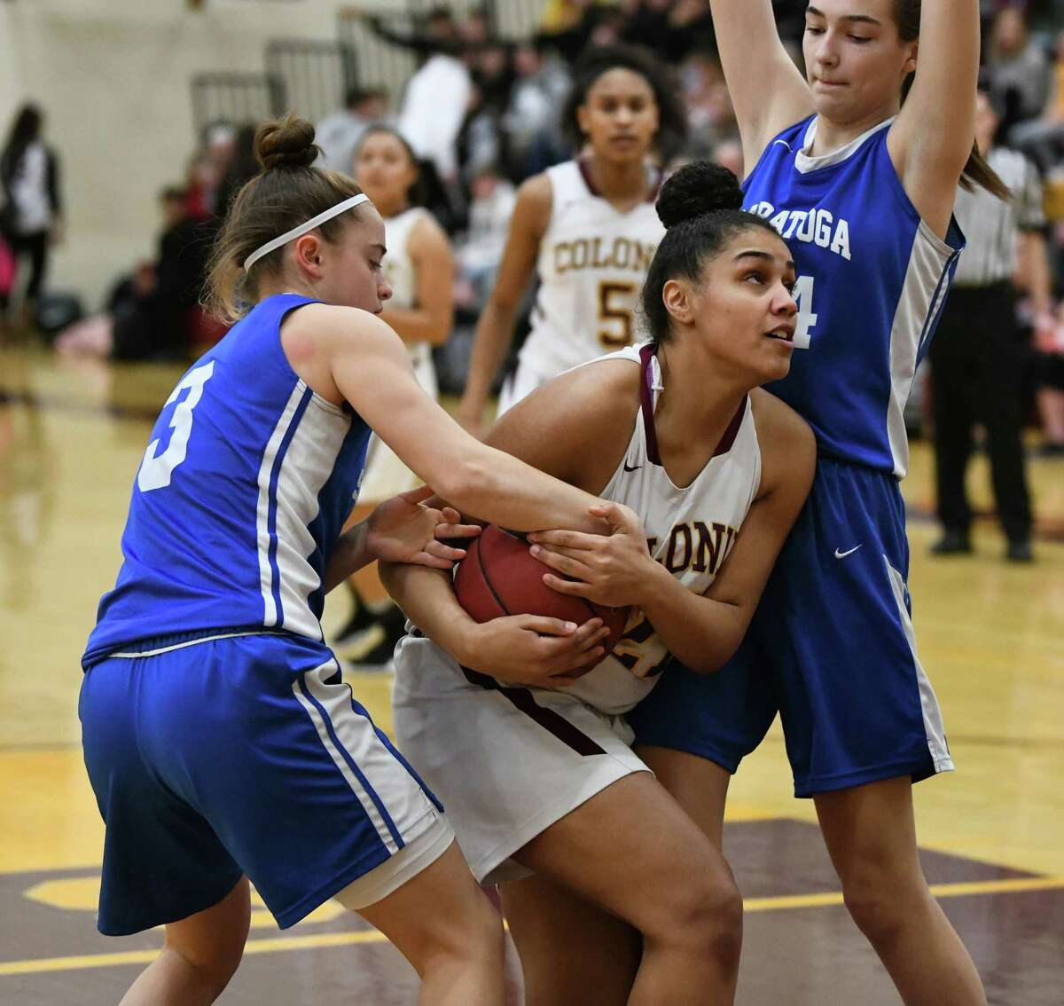 Colonie's Sareena DiCerbo drives to the basket defended by Saratoga's Catherine Cairins, left, and Natasha Chudy, right, during a basketball game on Tuesday, Feb. 5, 2019 in Colonie, N.Y. (Lori Van Buren/Times Union)