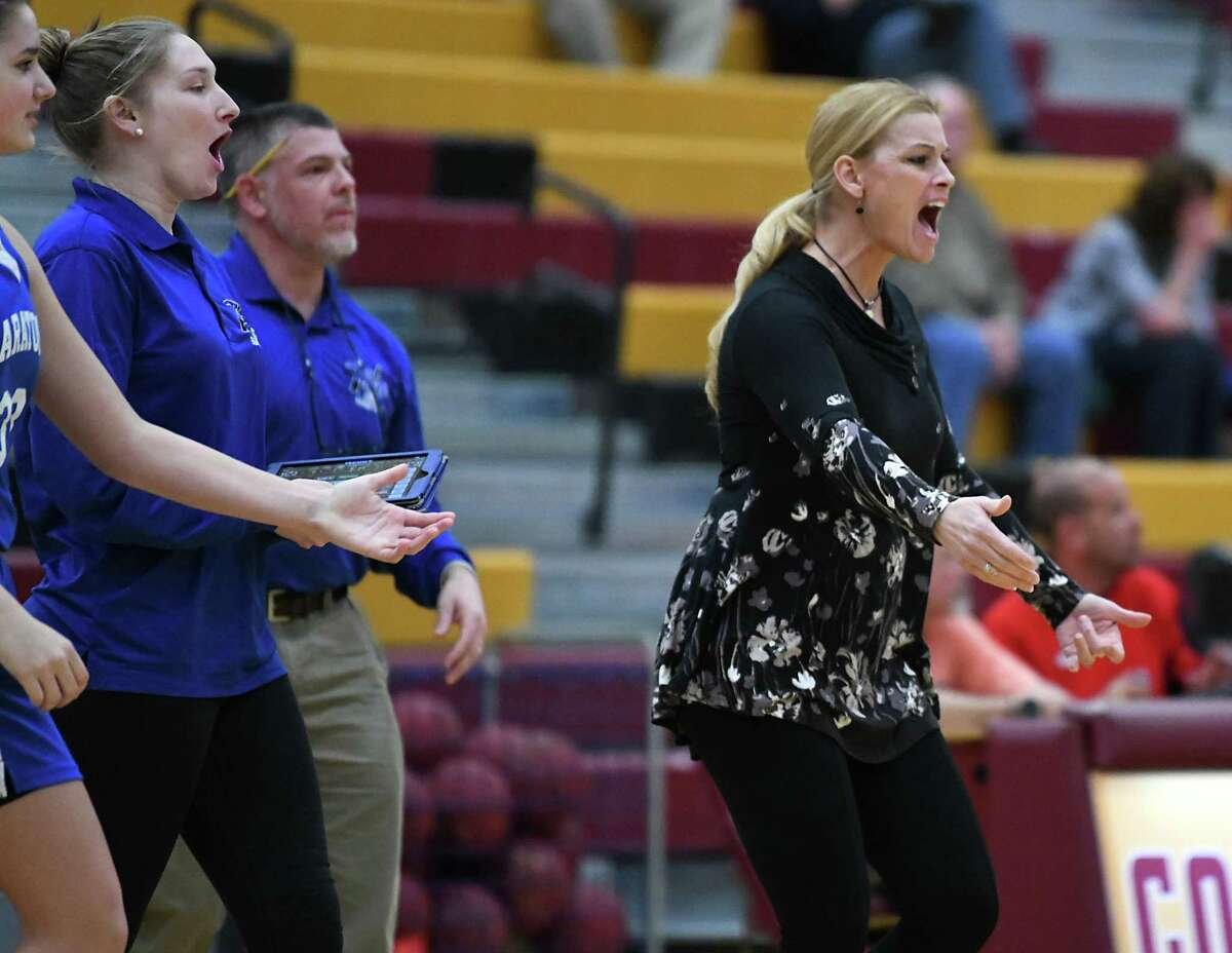 Saratoga Springs head coach Robin Chudy calls her players in at a timeout after a great play during a basketball game against Colonie on Tuesday, Feb. 5, 2019 in Colonie, N.Y. (Lori Van Buren/Times Union)