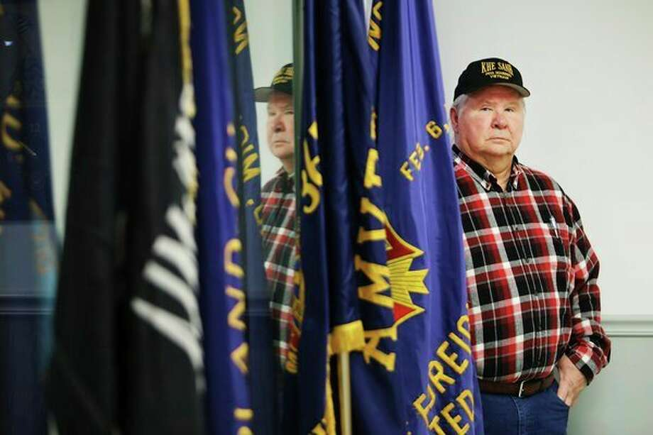 Veterans of Foreign Wars Chemical City Post #3651 commander Wayne DeVerney of Midland poses for a portrait inside the hall at 3013 Bay City Road on Tuesday. Today the post is celebrating its 75th anniversary. For more photos, go to www.ourmidland.com. (Katy Kildee/kkildee@mdn.net)