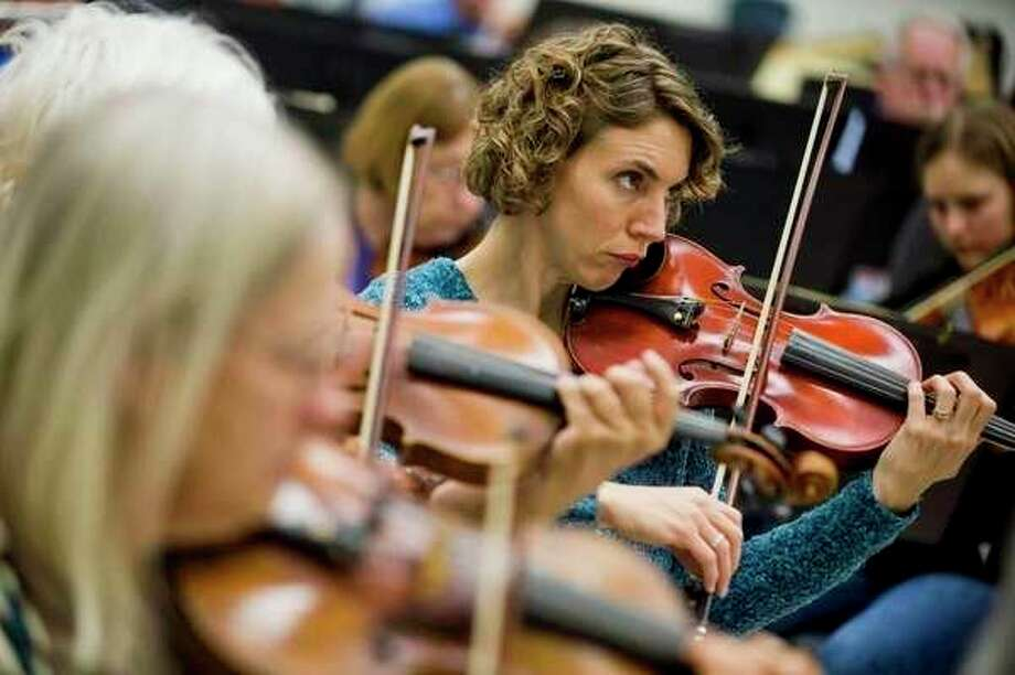 Midland Community Orchestra members rehearse in 2018. The orchestra will be in concert on Sunday, Feb. 10. (Daily News file photo)