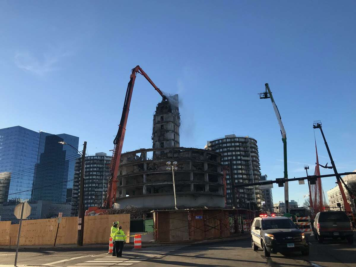 The demolition of one of the St. John towers continues on Wednesday, Feb. 6, 2019 in Stamford. Overnight the seventh floor collapse made the tower unstable. Police closed Tresser Boulevard while crews worked to stablize the tower. Tresser Boulevard is now open. Washington Boulevard is expected to remain closed most of the day.