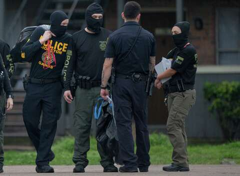Eight suspects arrested in SW Houston raid that netted trove
