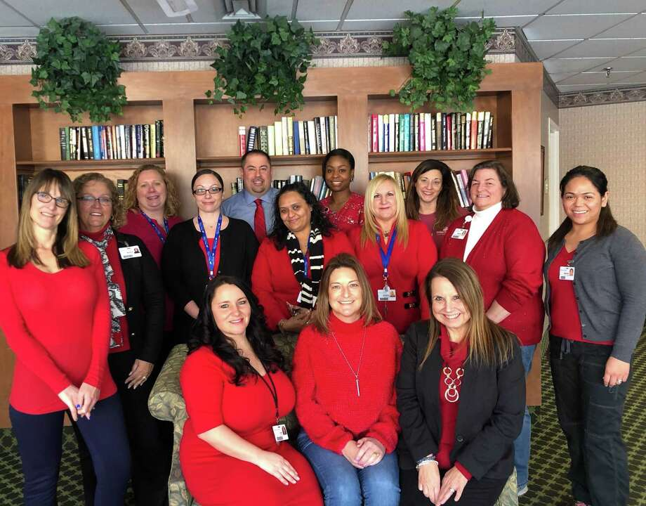 Staff of Water's Edge are pictured with Tara Stermer, seated at center, heart attack survivor at 47. National Wear Red Day / Go Red for Women, held Feb. 1, was the kick-off to American Heart Month. Stermer is the Water's Edge 2019 ambassador in promoting heart health for women. Photo: Contributed Photo