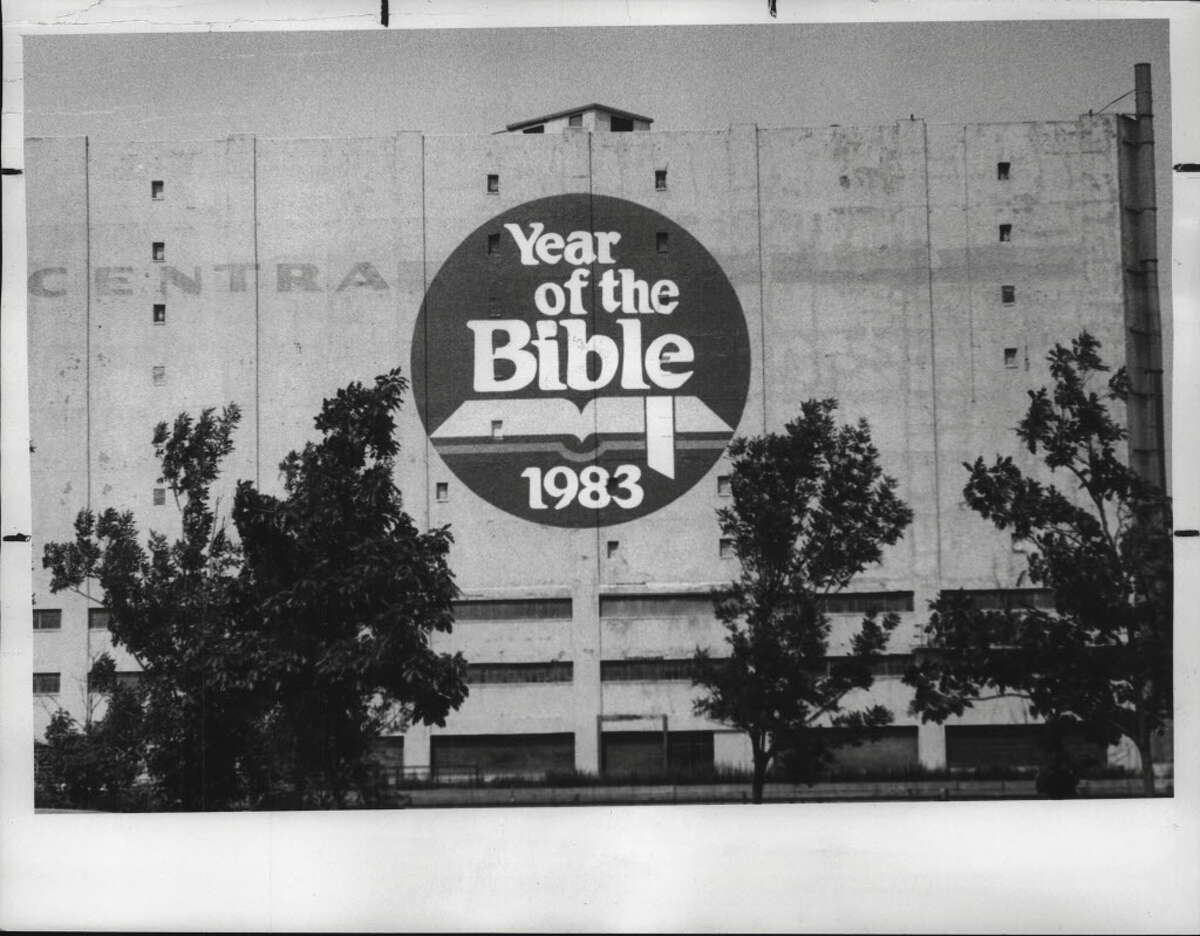 """The warehouse was emblazoned with a """"Year of the Bible"""" mural in 1983. The owners of CW Montgomery LLC bought the building in 2007 for $1.4 million with plans to turn it into a shopping and residential complex, but those plans fell through."""