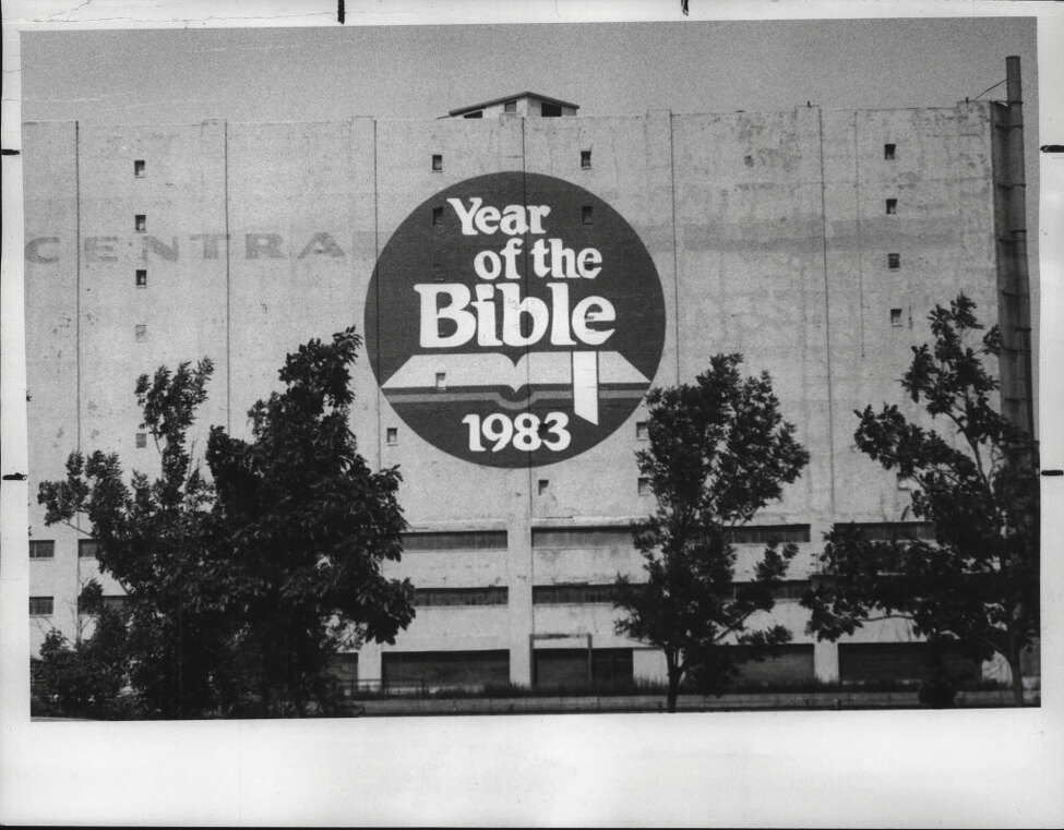 Central Warehouse sign says, Year of the Bible. June 15, 1983 (Hai Do/Times Union Archive)
