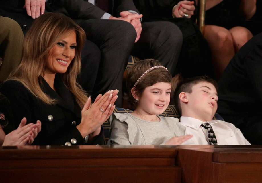 First lady Melania Trump with Grace Eline and Joshua Trump, special guests of President Donald Trump, attend the State of the Union address in the chamber of the U.S. House of Representatives on February 5, 2019 in Washington, DC. President Trump's second State of the Union address was postponed one week due to the partial government shutdown. Photo: Alex Wong/Getty Images