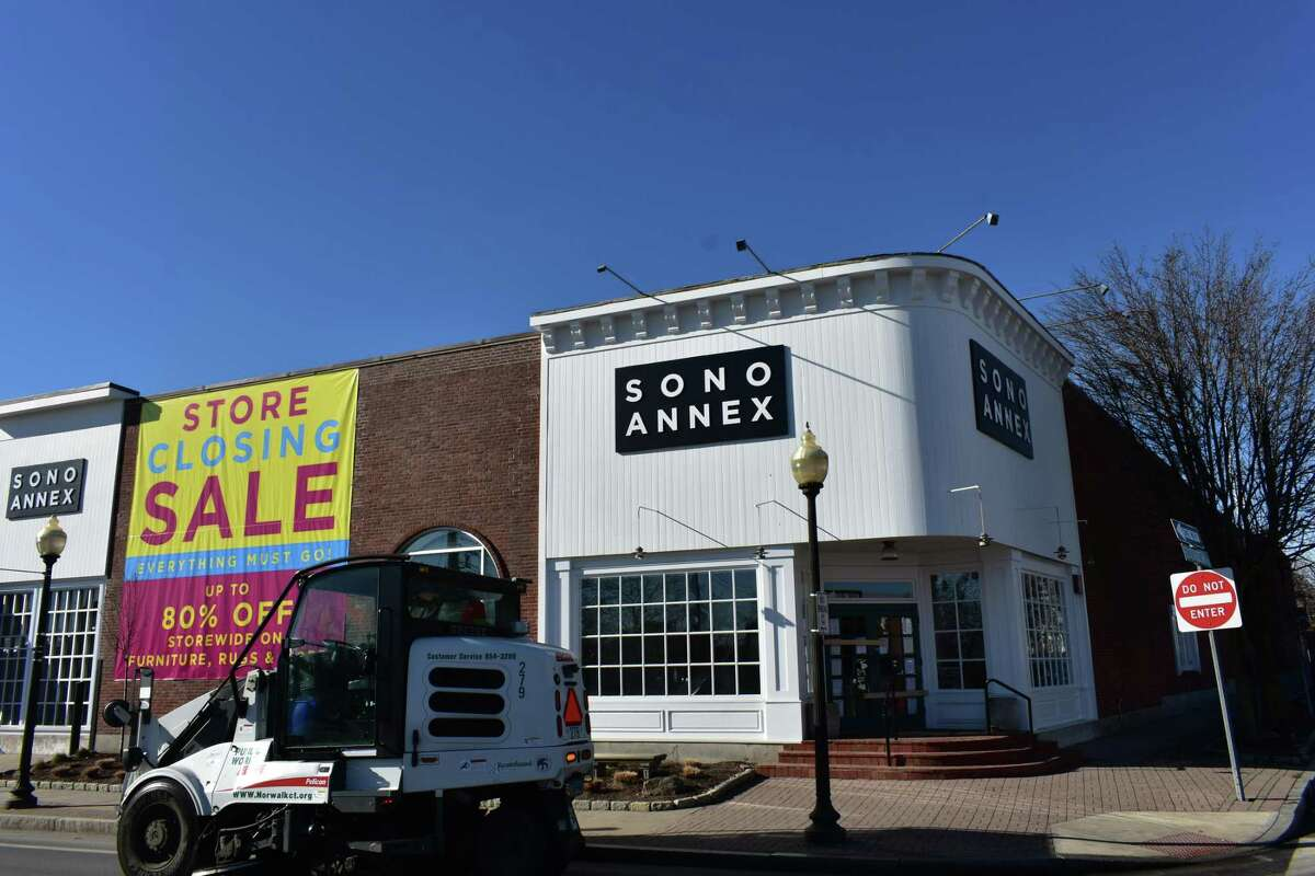 A street sweeper passes by the shuttered Lillian August SoNo Annex store on Wednesday, Feb. 6, 2019, at 85 Water St. in South Norwalk, Conn.