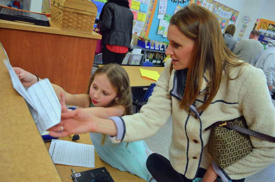 Clair Zuanelli, 7, of Easton, shares some details about being Taylor Swift with her mom, Karen, at the 2nd grade's living wax museum at Samuel Staples Elementary School, Friday, Feb. 1, 2019, in Easton, Conn. Photo: Jarret Liotta / For Hearst Connecticut Media / Fairfield Citizen News Freelance