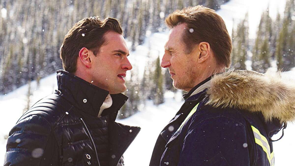 Liam Neeson, right, plays a grieving father who faces off against a drug lord (Tom Bateman).