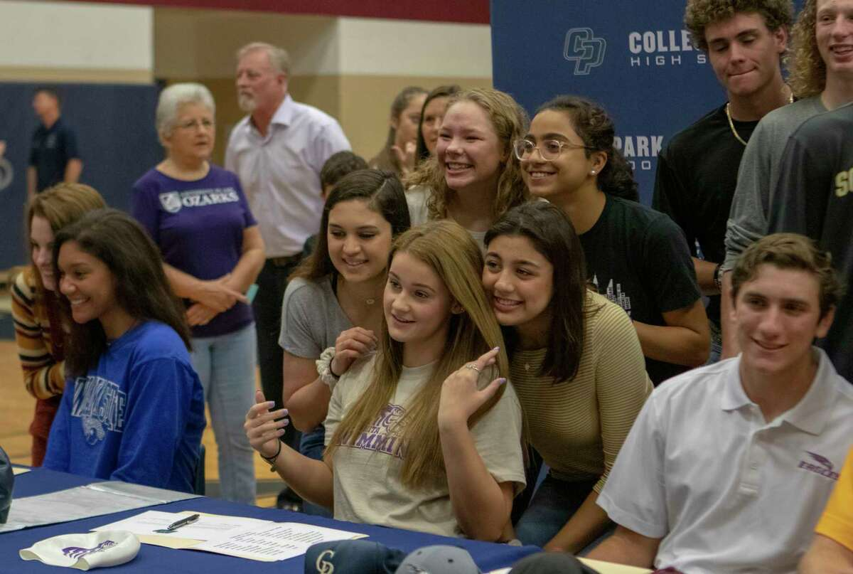 College Park senior Kaitlyn Montgomery poses for photos with freinds during National Signing Day on Wednesday, Jan. 6, 2019 at The Woodlands College Park High School in The Woodlands.