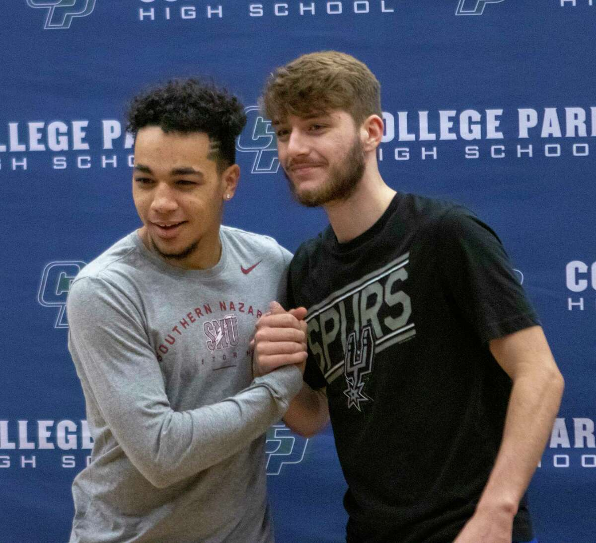 College Park senior Aaron Randle poses with a friend during National Signing Day on Wednesday, Jan. 6, 2019 at The Woodlands College Park High School in The Woodlands.