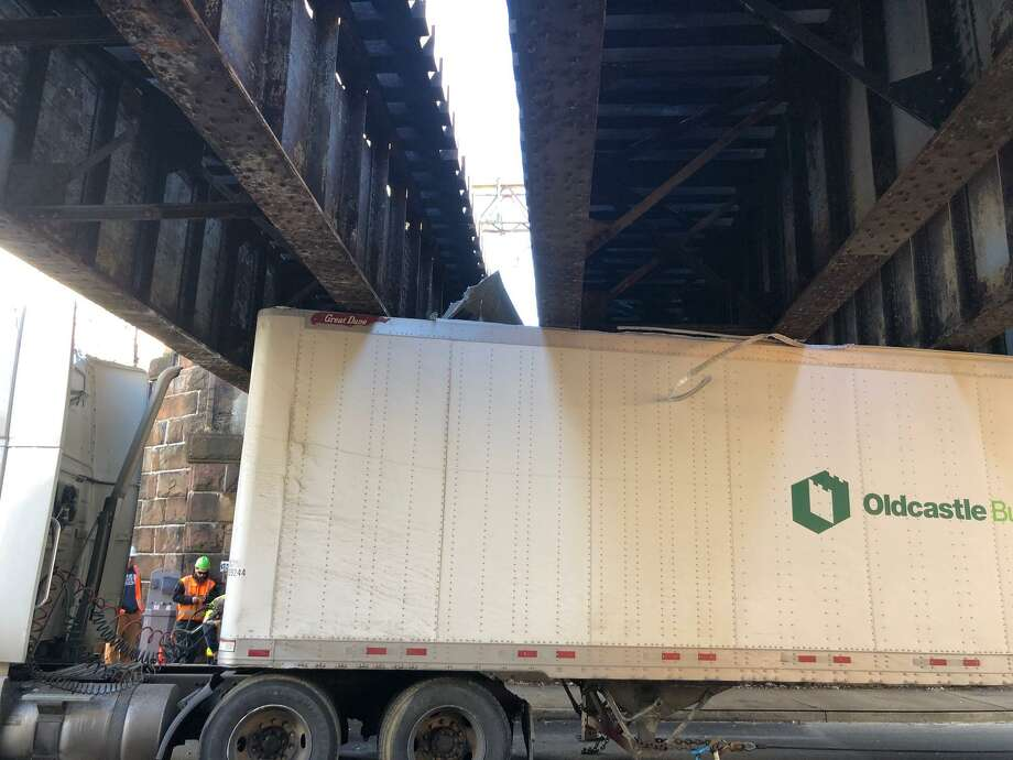 A tractor-trailer is stuck under the railroad underpass on Steamboat Road on Wednesday morning. Photo: Contributed /