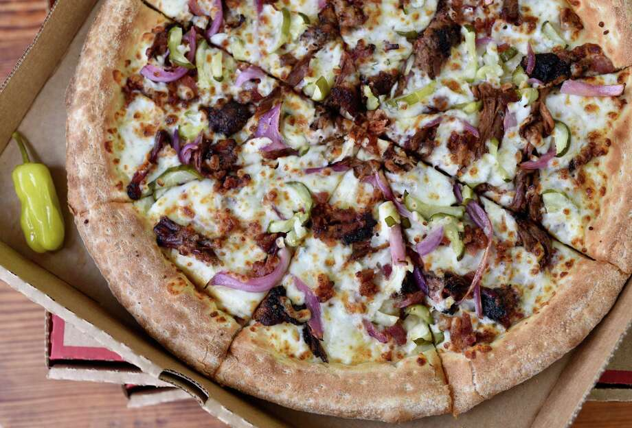 Killen's Barbecue in Pearland is teaming with Papa John's Houston for a special, limited-edition Killen's Barbecue Brisket Pizza, available Feb. 18 to March 31 for Rodeo season at all Papa John's pizza restaurants in Houston. Photo: Kimberly Park / Kimberly Park
