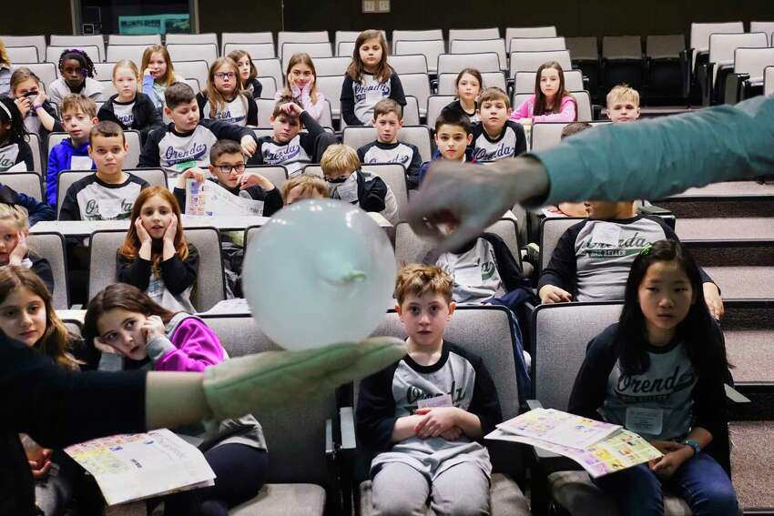 Fourth grade students from Orenda Elementary School in Clifton Park watch to see if a balloon will pop during an experiment with liquid nitrogen during an event at SUNY Polytechnic Institute on Wednesday, Feb. 6, 2019, in Albany, N.Y. SUNY Poly teamed up with Tokyo Electron (TEL), to provide the students with a presentation including experiments with liquid nitrogen, followed by tours and hands-on experiments related to circuits, magnets, Legos and gears. (Paul Buckowski/Times Union)