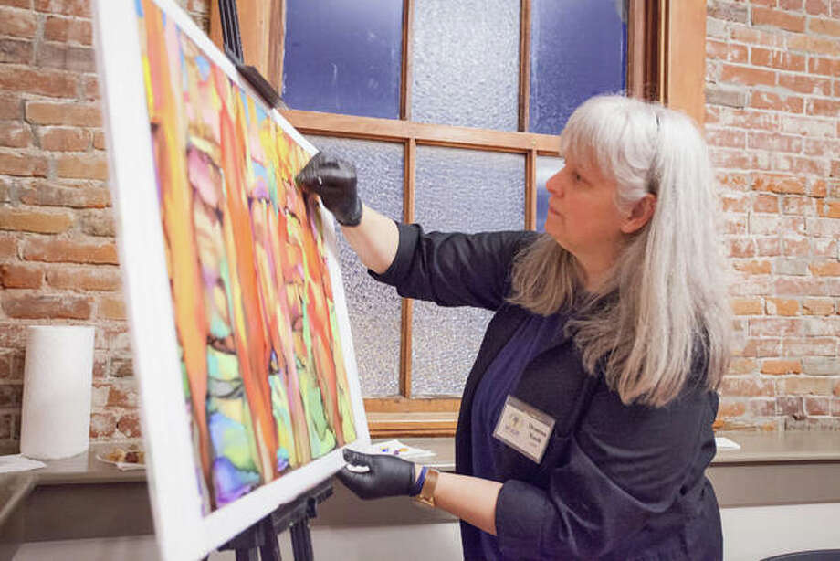 An artist finishes creating her piece during the inaugural Art Alive event presented by Edwardsville Arts Center last year. Photo: For The Intelligencer
