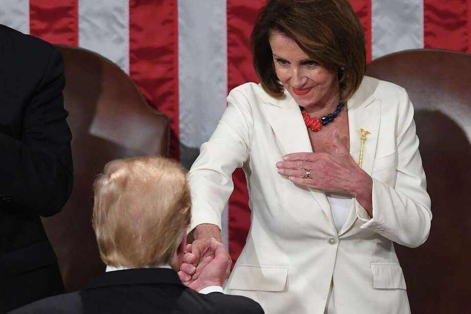 TOPSHOT - US President Donald Trump (L) shakes hands with Speaker of the US House of Representatives Nancy Pelosi during the State of the Union address at the US Capitol in Washington, DC, on February 5, 2019. (Photo by SAUL LOEB / AFP)SAUL LOEB/AFP/Getty Images Photo: SAUL LOEB, AFP/Getty Images / AFP or licensors
