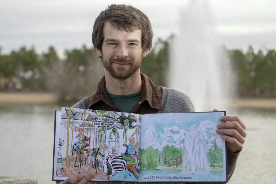 Author Zach Merta holds open his recently published to the page of the fountain he illustrated Wednesday, Jan. 30, 2019 at Rob Fleming Park in The Woodlands. Photo: Cody Bahn, Houston Chronicle / Staff Photographer / © 2018 Houston Chronicle