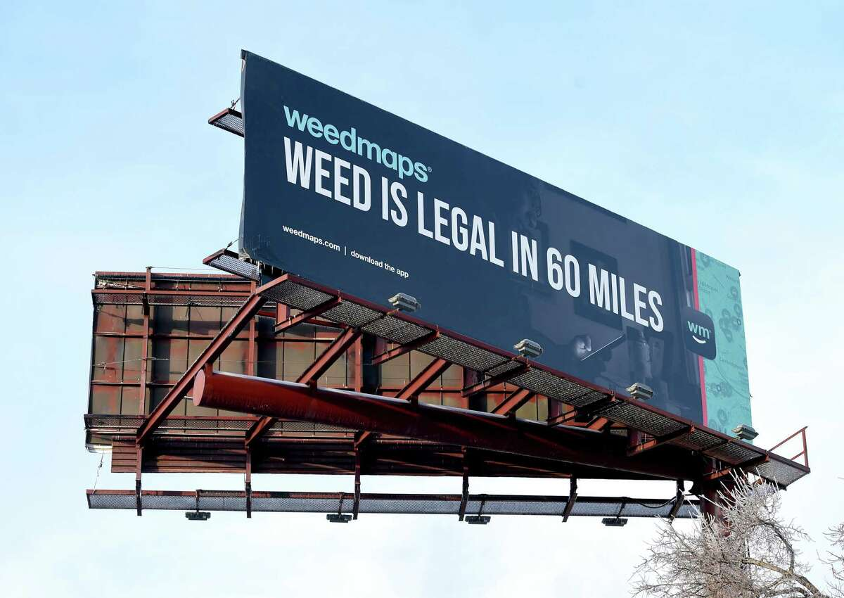 A billboard advertising marijuana in Massachusetts faces travelers on northbound Interstate 91 in New Haven.
