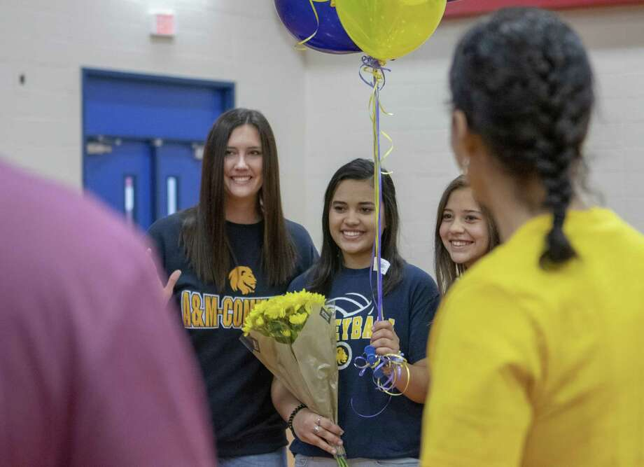 Oak Ridge senior Nina Hauff poses for photos with volleyball coach Rachel Croley during National Signing Day on Wednesday, Feb. 6, 2019 at Oak Ridge High School in Oak Ridge North. Photo: Cody Bahn,  Houston Chronicle / Staff Photographer / © 2018 Houston Chronicle