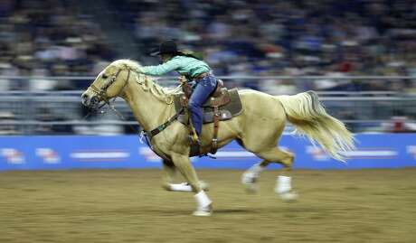 Hailey Kinsel rides in the Barrel Racing competition during Super Series II, round 2 at the Houston Livestock Show and Rodeo at NRG Stadium, Saturday, March 3, 2018, in Houston. ( Karen Warren / Houston Chronicle )