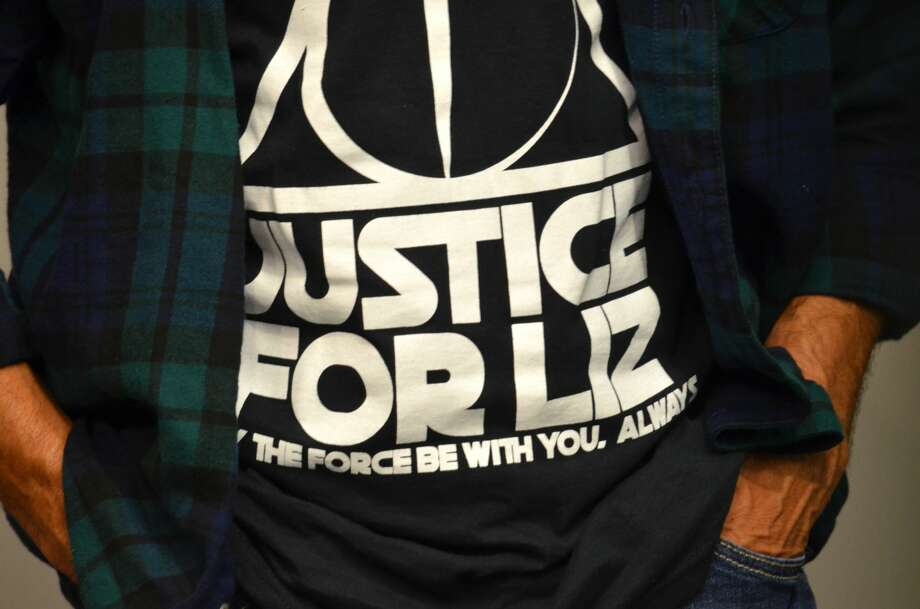 """A loved one of Elizabeth """"Liz"""" Barraza is seen wearing a special shirt during a press conference Feb. 6, 2019 asking for the public's help in solving Barraza's shooting death. Photo: Jay R. Jordan"""