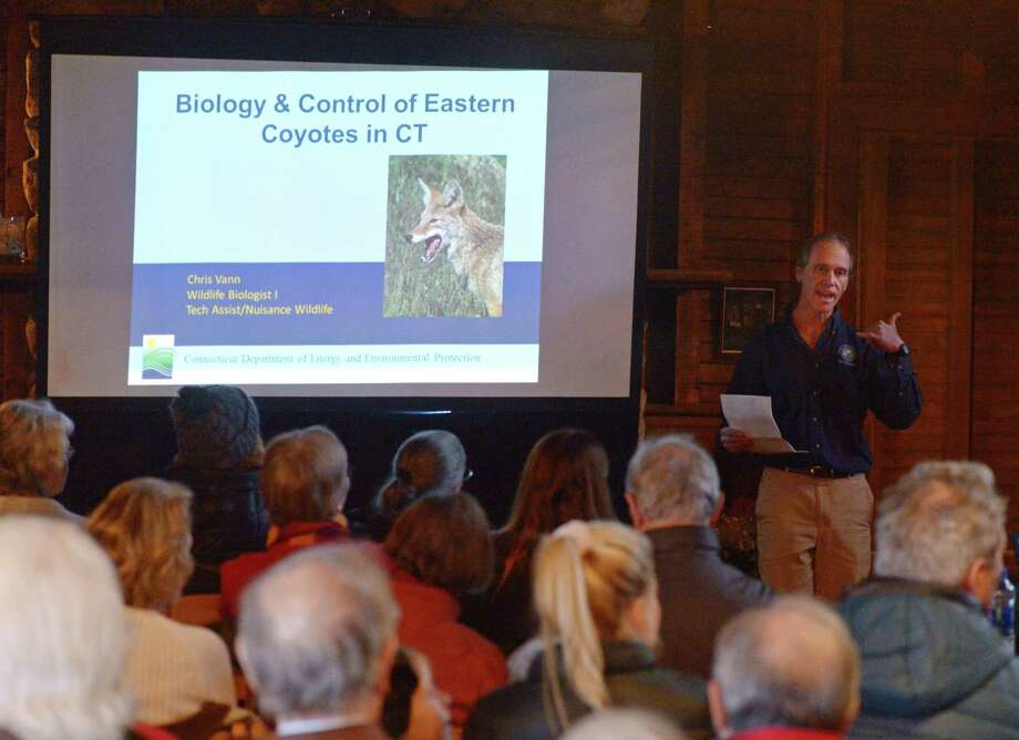 "Chris Vann from CT DEEP speaks during the ""Living with Coyotes"" Science Sunday presentation at the Greenwich Point Park Seaside Center in Old Greenwich, Conn. Sunday, Feb. 3, 2019. Presented by the Bruce Museum, Chris Vann from CT DEEP and Allyson Halm from New Canaan Animal Control discussed the nature of coyotes and practical tips for homeowners and pet owners to ensure the safety of themselves, their pets and their property. Photo: Tyler Sizemore / Hearst Connecticut Media / Greenwich Time"