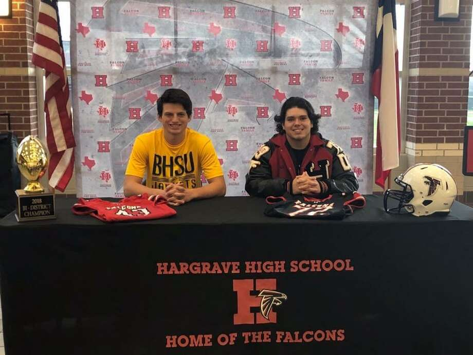 Hargrave defensive linemen Caleb Tiffin (left) and Seth Cozart (right) pose for a picture together after each signed his National Letter of Intent during a ceremony at Hargrave High School on the morning of Wednesday, Feb. 6 Photo: Huffman ISD Facebook Page