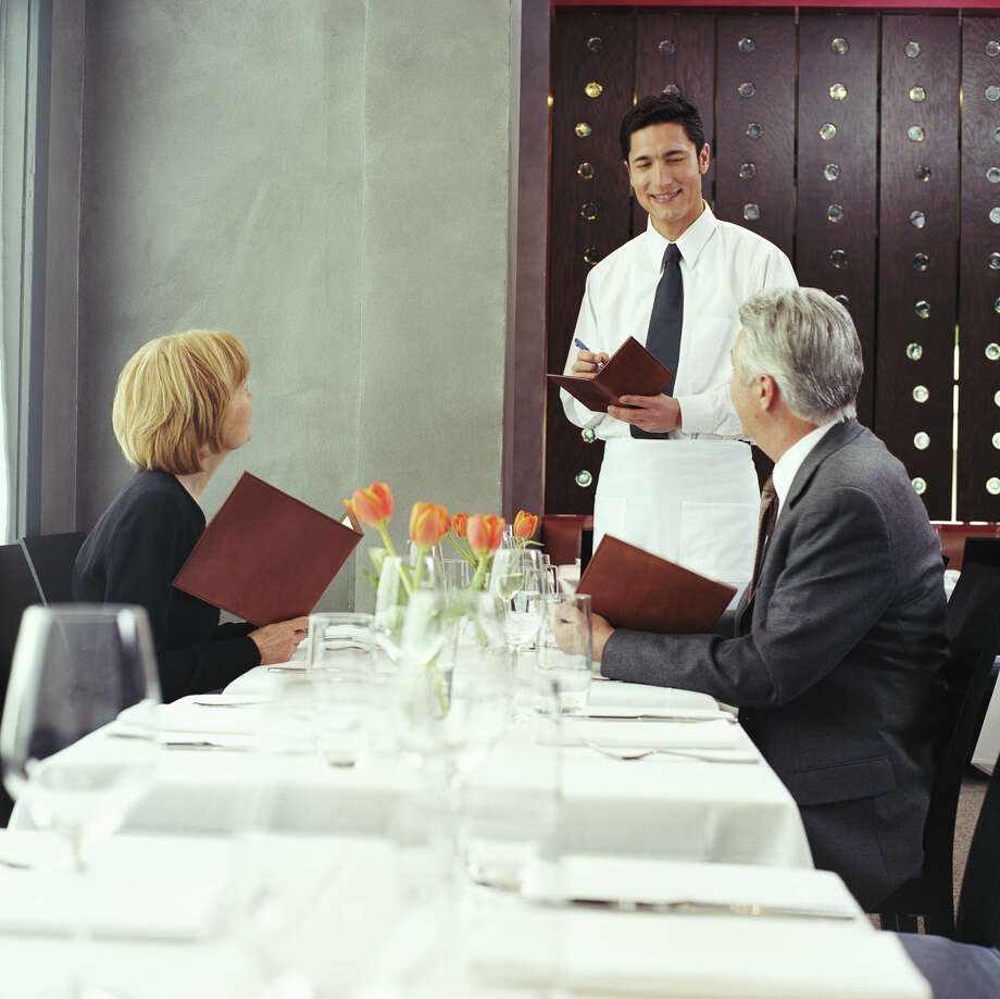A husband is upset at his wife after she flirted with the waiter. Photo: Nico Kai/Getty Images