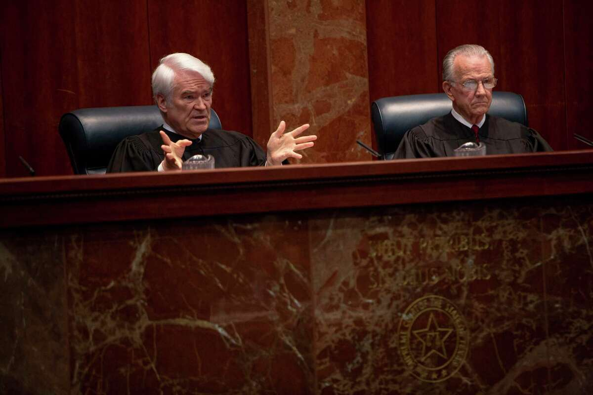 Texas Supreme Court Chief Justice Nathan Hecht speaking to Hays Street Bridge Resoration Group attorney, Amy Kastely, at the Texas Supreme Court on Thursday.