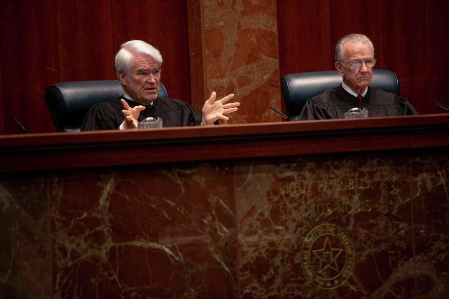 Texas Supreme Court Chief Justice Nathan Hecht speaking to Hays Street Bridge Resoration Group attorney, Amy Kastely, at the Texas Supreme Court on Thursday. Photo: Spencer Selvidge For The San Antonio Express News / Spencer Selvidge For The San Antonio Express News / Copyright Spencer Selvidge for the San Antonio Express News